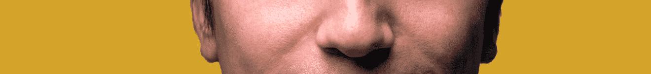 Visage nez homme de 30 ans sur fond jaune